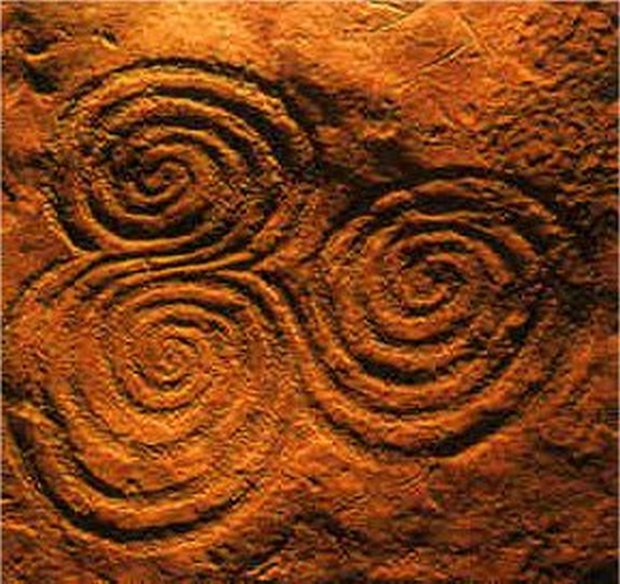 triple-spiral-on-rock